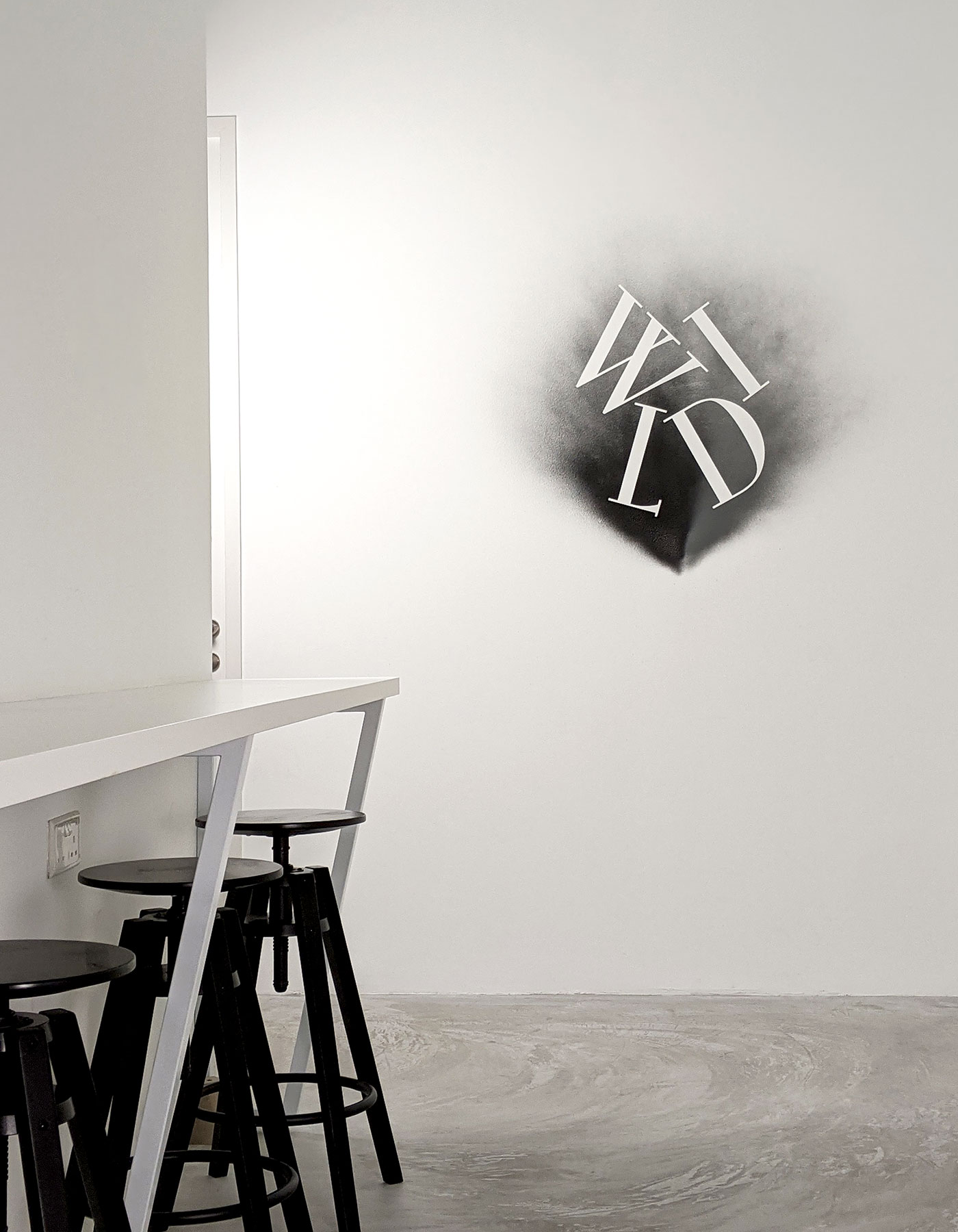 Interior of Wild Advertising & Marketing's office, a Singapore-based creative agency, with its logo on the wall