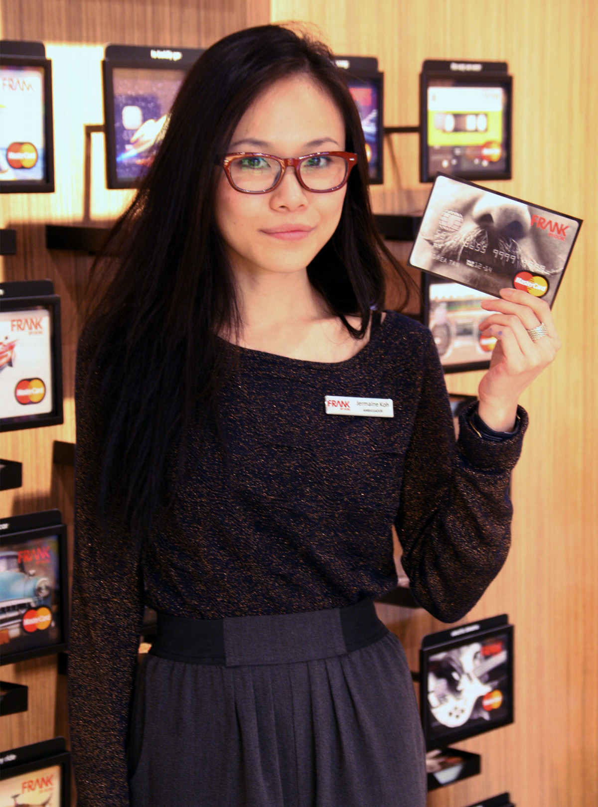 A woman poses with a FRANK by OCBC card design at the brand's launch event